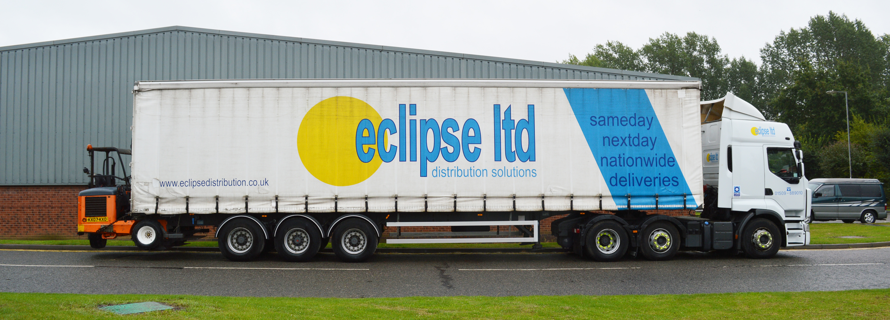 An image showing the side view of an Eclipse Distribution lorry parked outside.