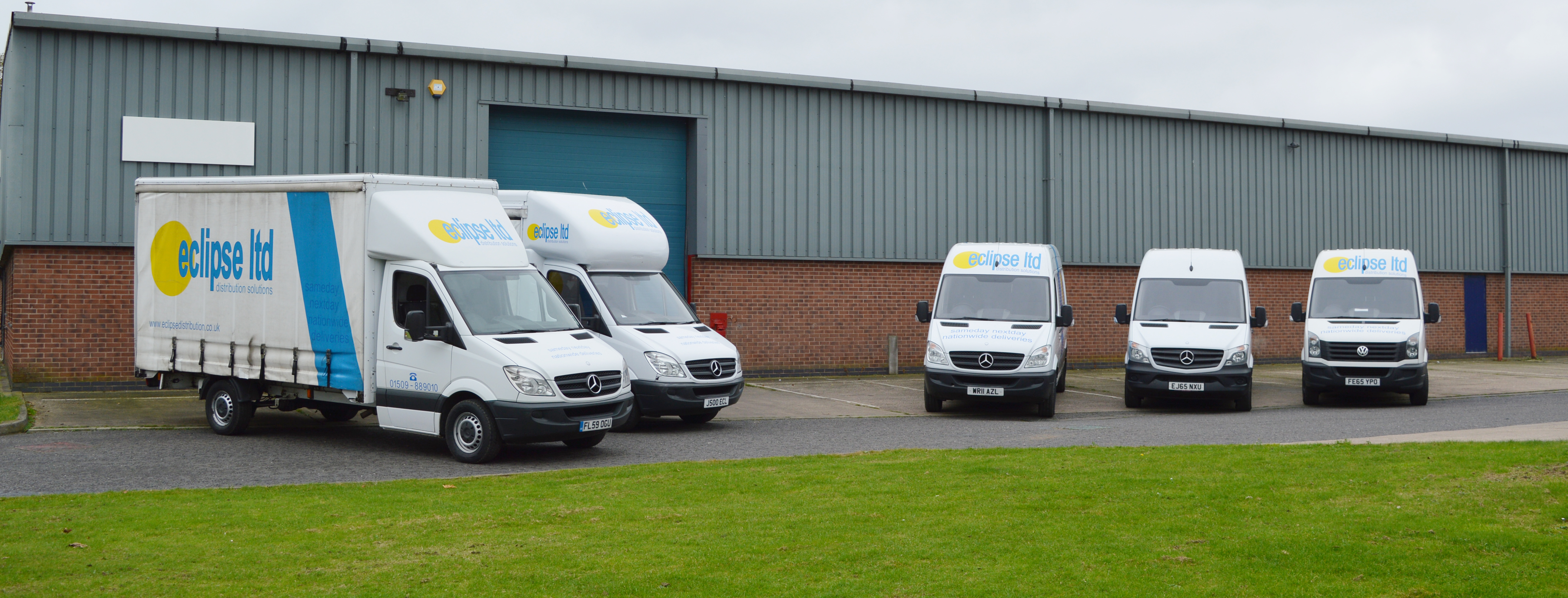 An image of five Eclipse Distrubution delivery vans parked at the depot.