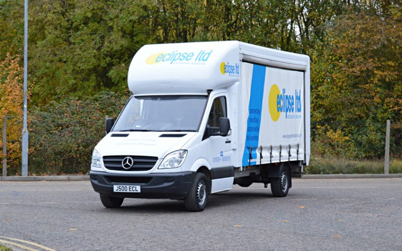 An image showing a white Eclipse Distribution Sprinter van parked outside, used for nationwide parcel delivery.