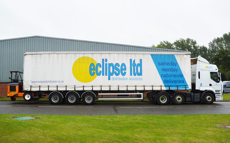 An image showing the side view of an Eclipse Distribution Solutions Ltd lorry parked outside used for pallet delivery.
