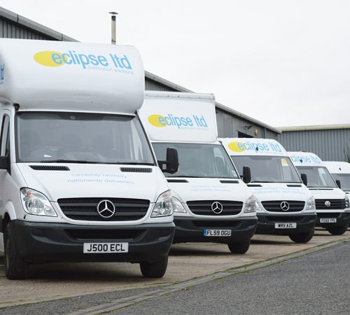 An image showing six Eclipse Distribution Solutions Ltd vans lined up outside in Loughborough.