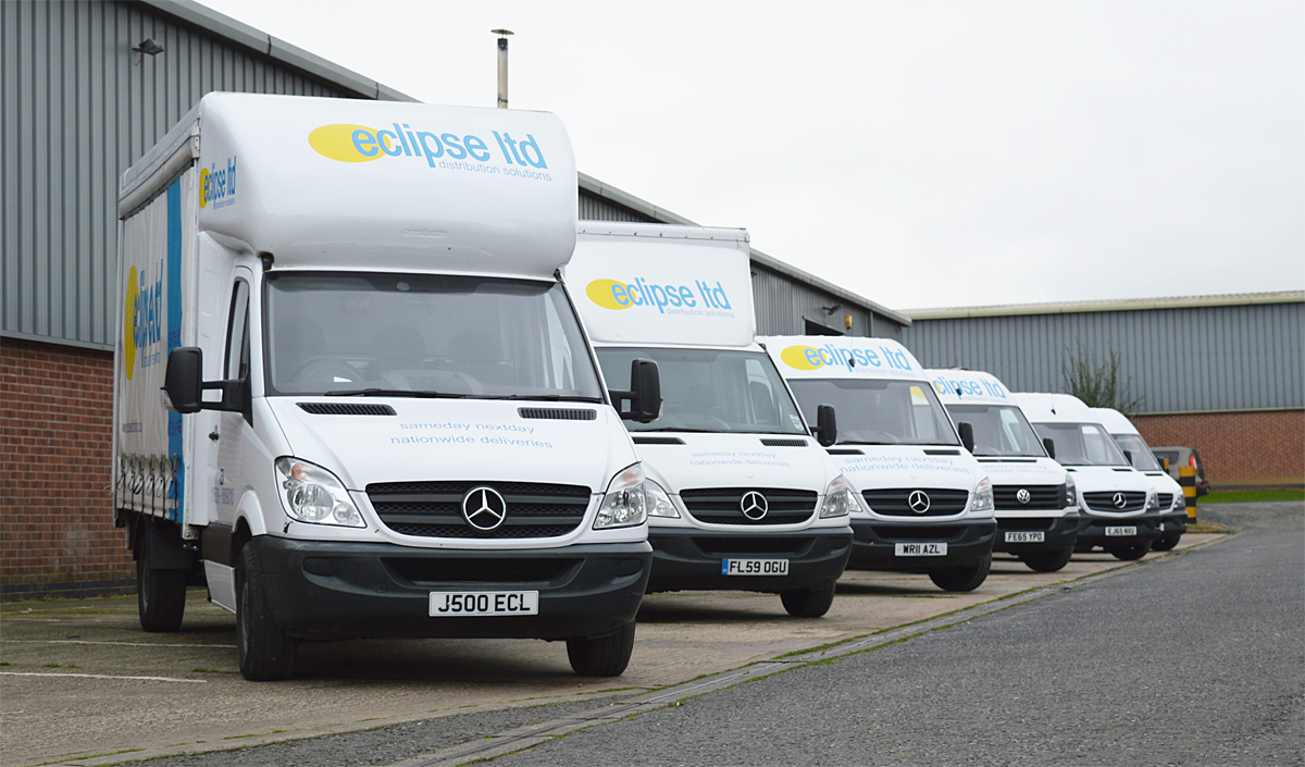 An image showing six Eclipse Distribution Solutions Ltd vans lined up outside.