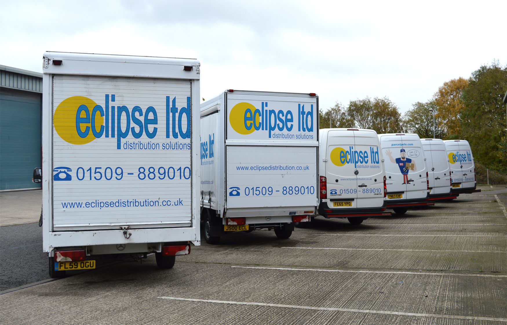 An image showing the rear view of a fleet of Eclipse Distribution Solutions Ltd vans and lorries in various sizes parked outside.