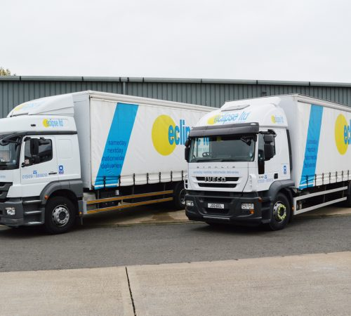 An image of two Eclipse Distribution Solutions lorries used for haulage solutions parked next to each other at the delivery depot.