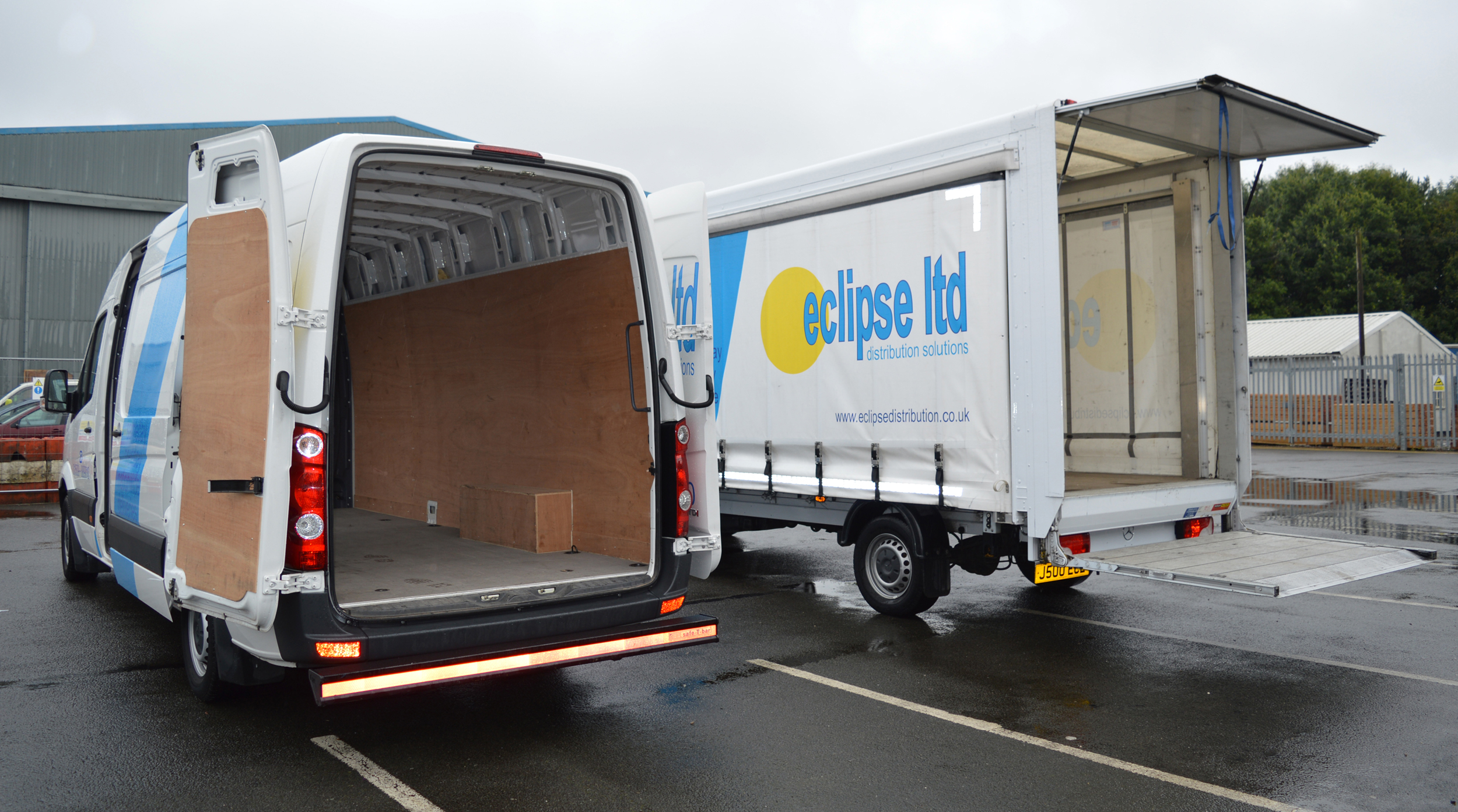 An image showing the rear view of two Eclipse Distribution Solutions vans with open doors.