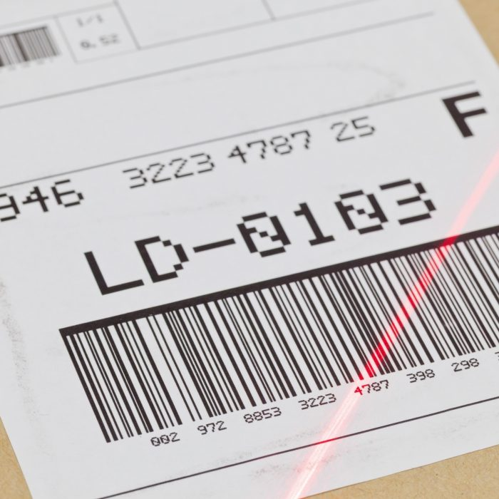 An image of a parcel tracking label being scanned.