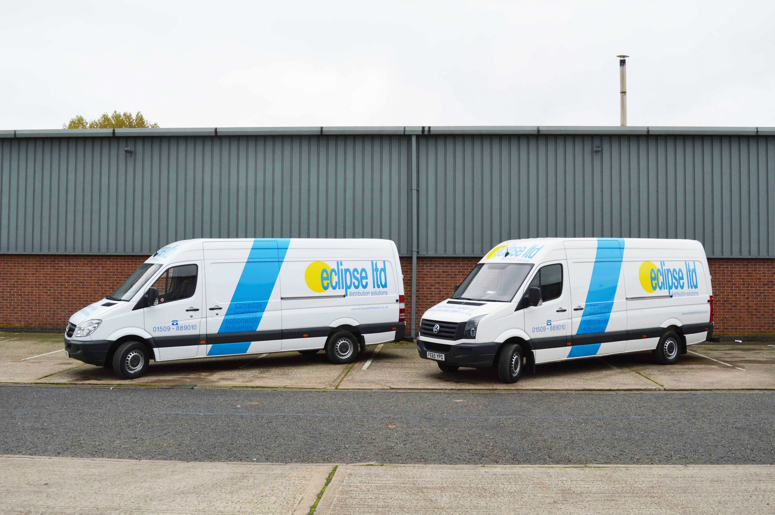 An image of the Side View of two Eclipse Distribution Solutions van used for nationwide delivery