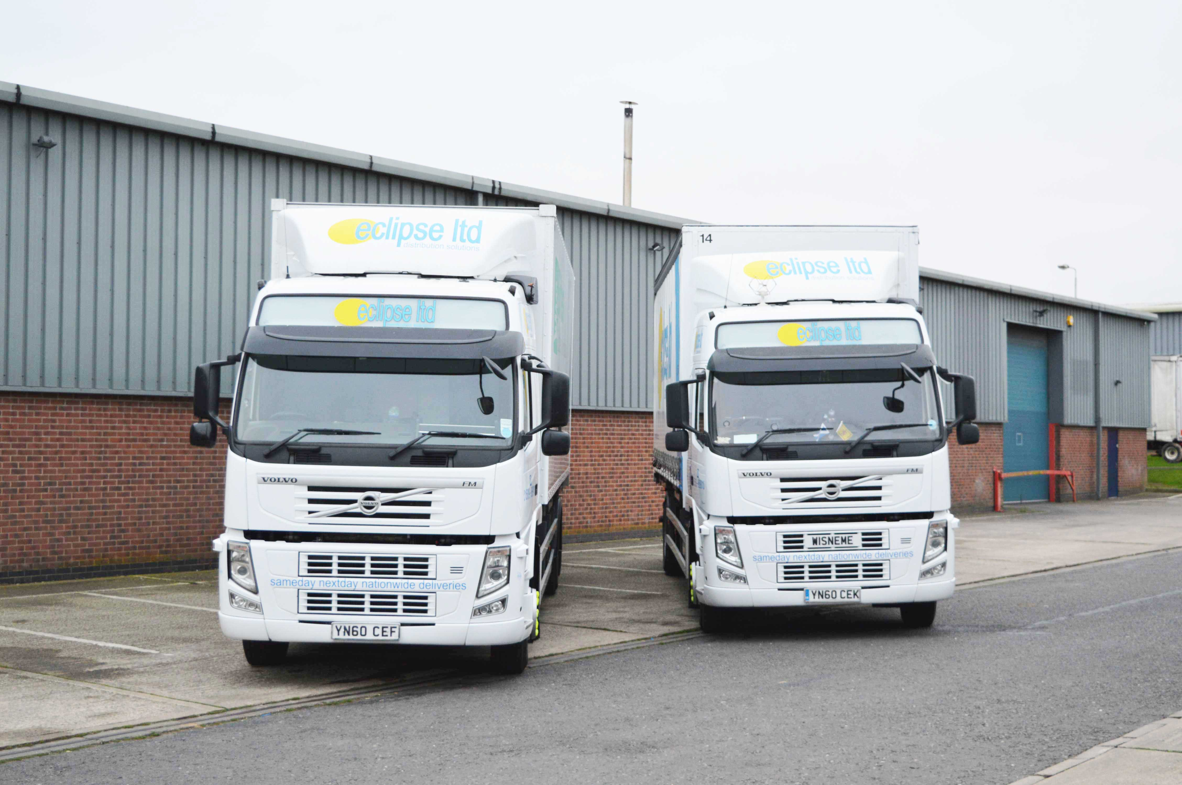 An image of two Volvo lorries.