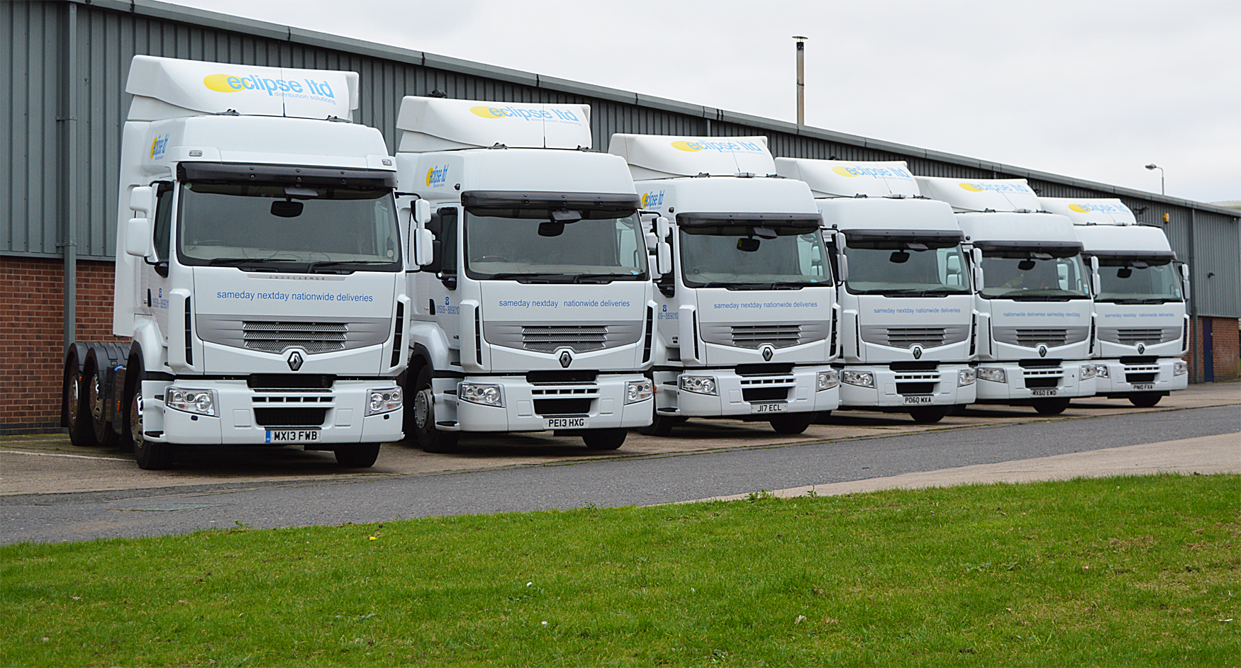 An image showing a fleet of six Eclipse Distribution Solutions Ltd lorries parked in a row outside their depot in Loughborough.