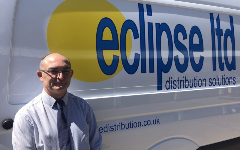 An image of an Eclipse Distribution Solutions Ltd team member, standing next to a delivery van.