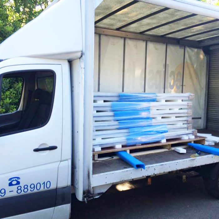 An image showing the inside of an Eclipse Distribution Ltd van with storage pallets inside.