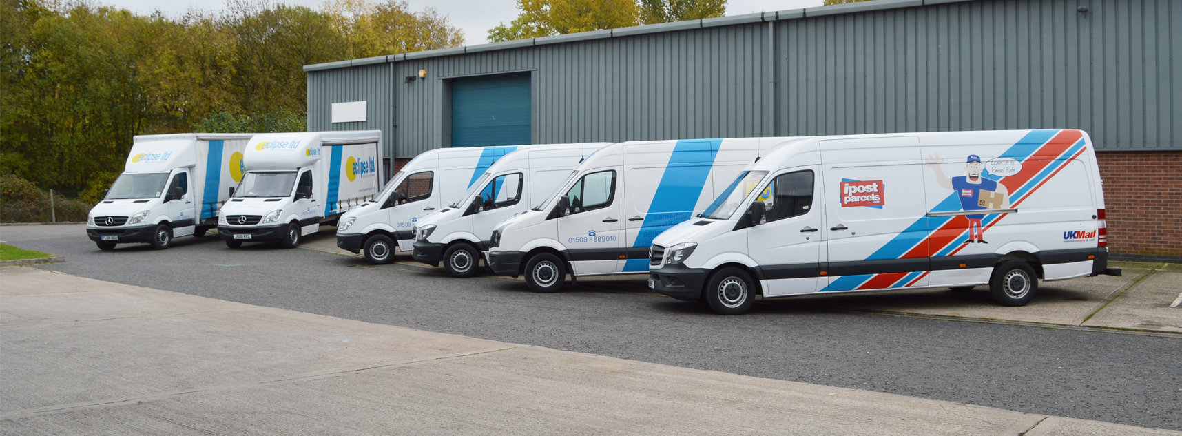 An image showing a fleet of delivery vans used to transport large and small parcels.