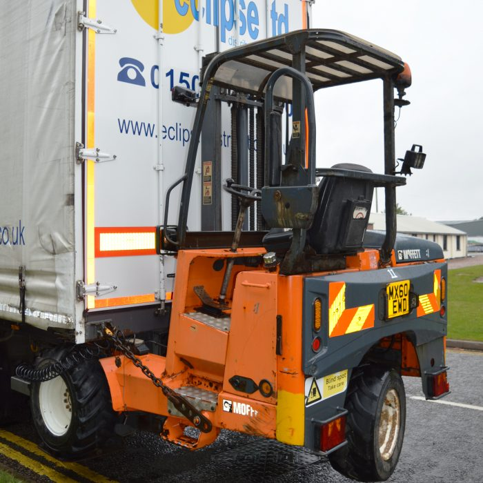 An image showing the back of an Eclipse Distribution Solutions Ltd lorry with a driver cart attached.