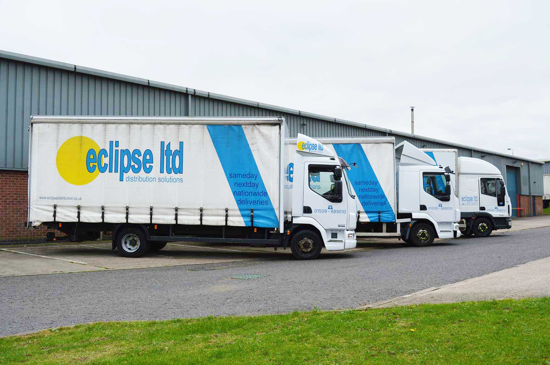 An image showing three Eclipse Distribution Solutions Ltd lorries parked outside.