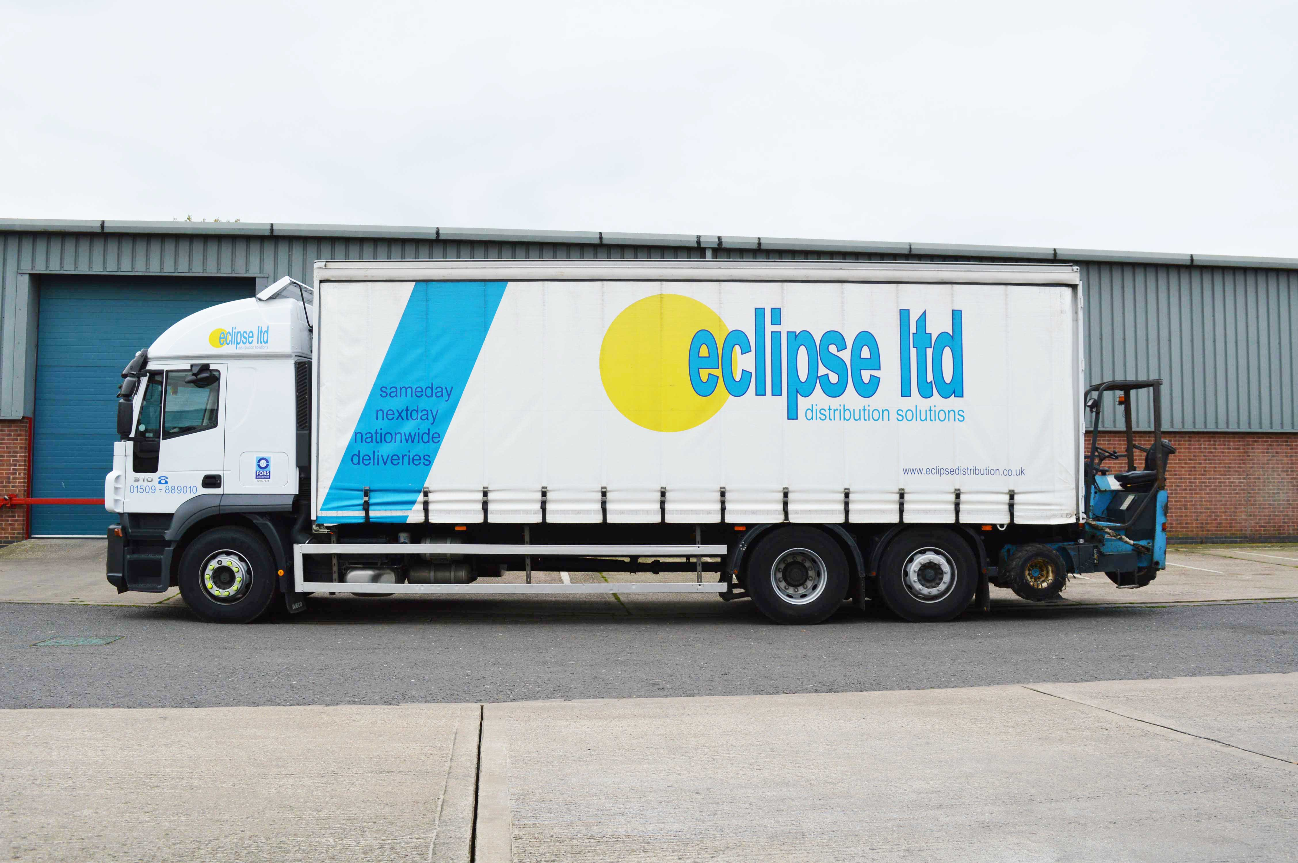 An image showing the side view of an Eclipse Distribution Solutions Ltd curtain sided lorry.