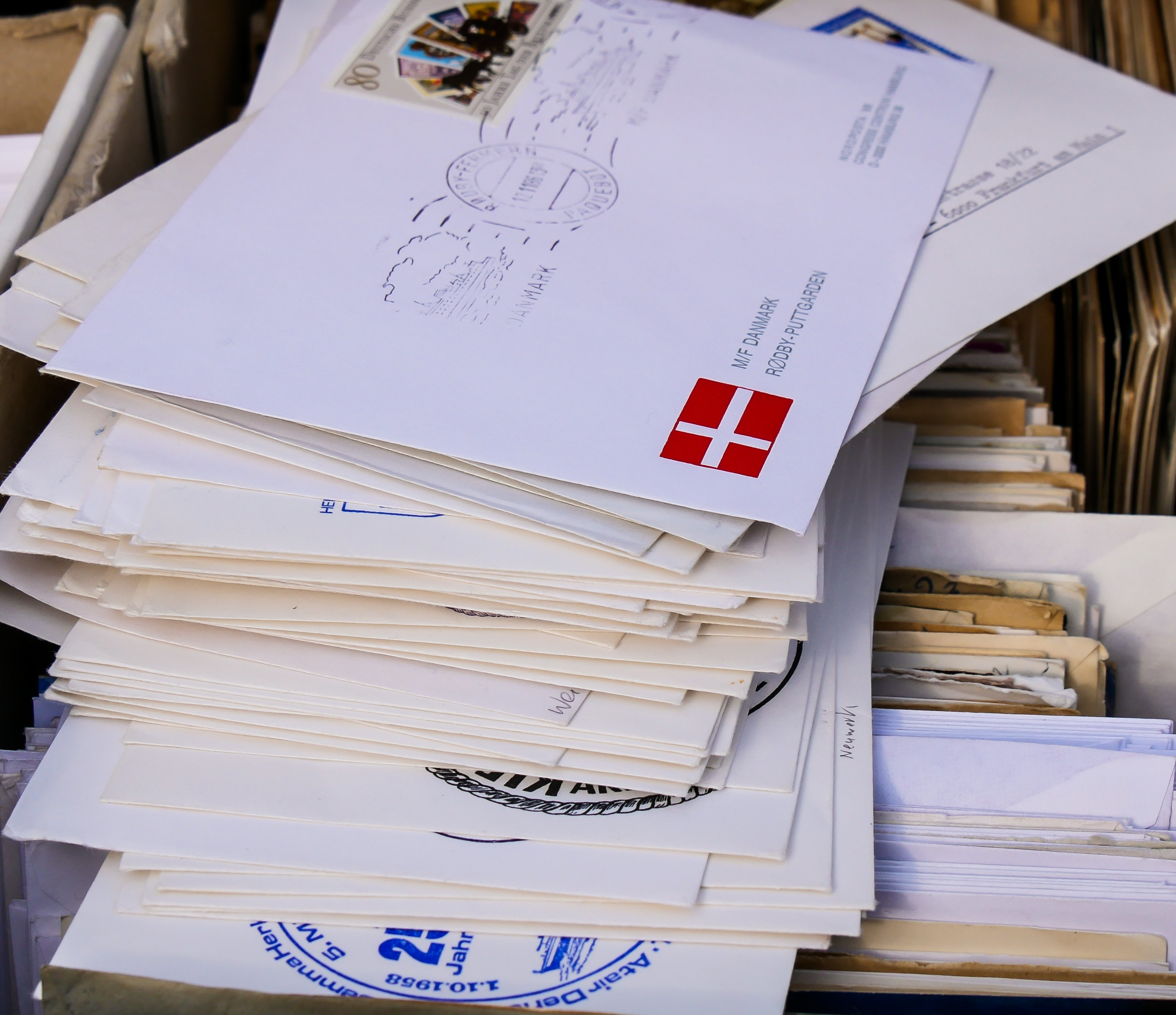 An image of a pile of letters to be sent through the post.